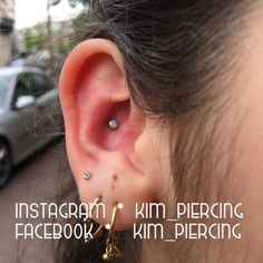 inner conch piercing with white opal jewellery from NeoMetal