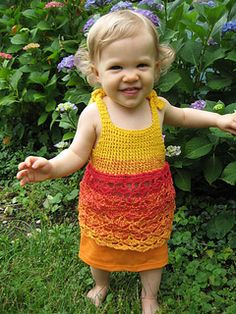 You often find inspiration in designs of others, this time from a little knit dress at Lion Brand Yarn. I'd been trying to design a pattern to use with the Wolle's Color Changing Cotton Yarn and seeing the cute little sundress in my e-mail sparked an idea. This lacy little dress, in the colors of a juicy mango or evening sunset, is the result.