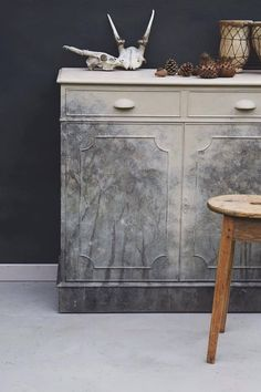 Former Annie Sloan Painter in Residence Jonathon Marc Mendes of Painted Love painted a beautiful winter inspired mural on the front of a small sideboard. He used Chalk Paint® by Annie Sloan with colors such as Cream, Château Grey, Graphite and Old White.
