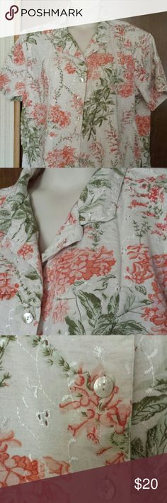 Lemon Grass Woman plus size button front shirt Lovely short sleeved shirt in cream, green and tangerine with eyelets in the cotton-linen blend fabric. Mother of pearl buttons, side slits, and turn down collar, this shirt can go to the office or just as easily to the park. Excellent used condition. Lemon Grass Woman Tops Button Down Shirts