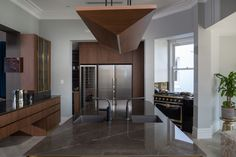 Custom designed kitchen with polished brass skirting boards and frames by high end Sydney kitchen designers. See more of this fabulous home including the black master bedroom kitchenette, bathroom and wardrobes. Dark Kitchens, Luxury Kitchens, Black Master Bedroom, Glass Cabinets, Skirting Boards, New Kitchen Designs, Kitchenette, Signature Collection, Beautiful Kitchens