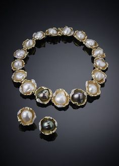 "Jewelry : Pearl Earclips and Necklace | Blouin Boutique  GRIMA Art Antiques London, June 13-20, Albert Memorial West Lawn    Baroque pearls held in yellow gold and diamond ""oyster shells,"" 1972"