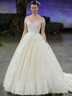 Ines Di Santo off the shoulder natural waist ball gown wedding dress in organza, tulle and alencon lace and finished with tiered pearl straps