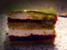 Matcha biscuit cake filled with lavander mousse and raspberry jelly