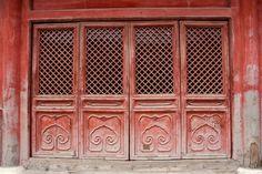 Red architectural flourish