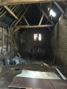The Farnborough Barn on the day we bought the site. The photo shows the main barn looking from what will be the living area back to the kitchen. Our team members Ashley and Dave are in the picture and give you an idea of the scale of the building!