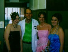 Bill Drilling poses with Brit, Ashley, and Heidi before their Senior Prom.