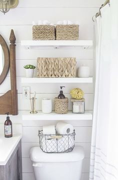 After they re-sheetrocked the walls, the couple installed inexpensive, faux shiplap on top and painted the entire room white. Rachel cleverly chose paint with a satin-finish so that light entering the (Diy Bathroom Storage) Shelves Above Toilet, Cabinet Above Toilet, Behind Toilet Storage, Faux Shiplap, White Shiplap, Simple Bathroom, Master Bathroom, Bathroom Small, Bathroom Hacks