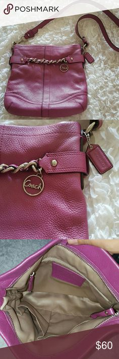 Auth Coach crossbody Berry color. Excellent condition: no stains, or tear. Strap is 21 inches long. 11 inches across from left to right on bottom, 10 inches long across top. Bags Crossbody Bags