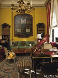The ormolu-mounted ebonized desk, 1730, in the library, came from Hubert de Givenchy's private collection ($17,000-$24,000). A Louis XV gilt-tooled leather and brass telescope sits on it ($6,700-$11,000).