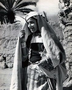 Africa | Young woman from Tiznit, Morocco. || Vintage print; early 20th century