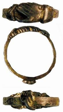 The piece, known as a 'fede' or faith ring, dates from the 14th or 15th century and features a pair of clasped hands and would have been worn as a love token.