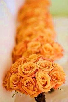 Orange roses for bridesmaids