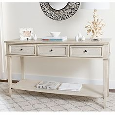 Inspired by Shaker furniture, the Manelin Console Table by Safavieh transcends decorating styles and eras with its classic form-follows-function aesthetic. It's finished with a subtle whitewash which brings out the wood grain.