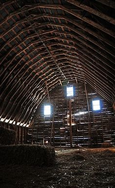 Inside Rafters Of Barn Built In 1944~ Round-Roof barns without sidewalls became increasingly common after 1945, imitating the design of the popular World War II Quonset Hut. Common elements:  1. semicircular or parabolic roof; 2. laminated wood or metal rafters.