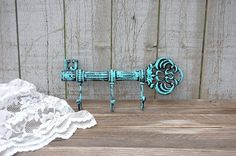 Cast iron, hand painted in aqua over black and finished with a protective clear coat. *Painted mounting screws are included.* wide and tall Painted Jewelry Boxes, Wall Mounted Hooks, Key Rack, Vintage Keys, Key Hooks, Shabby Chic Homes, Knobs And Pulls, Tiffany Blue, Farmhouse Decor