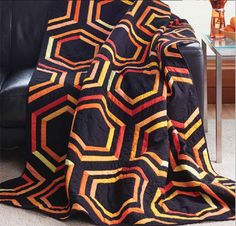 Valarie Ravitch's love for geometric patterns and bold colors shines in this modern hexagon quilt pattern download.