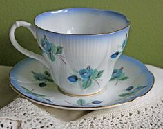 Tea Cup with Saucer by Royal Albert.  Bone China Hand Painted blue Roses. Horizon Series.  Made in England.
