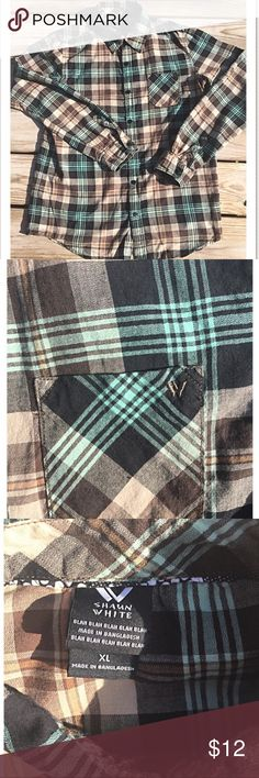 Shawn White Boys Junior Long Sleeve Plaid Shirt XL Made out of 100% Cotton. Shawn White Long Sleeve plaid shirt with beautiful fall/ winter color's of teal, brown, black, and caramel.  It works for all seasons but the earth tones remind me of fall! Very gently used! Great condition... Shawn White Shirts & Tops Tees - Long Sleeve