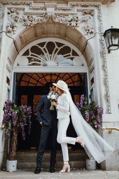 Bride in a white trouser suit paired with a lace top and white, ankle-strap sandals along with a wedding fedora adorned with a tulle veil. Wedding Photoshoot, Wedding Attire, Wedding Bride, Wedding Dresses, Wedding Blog, Wedding Lace, Womens Wedding Suits, Lace Bride, Green Wedding