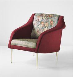 A rare armchair by CARLO DE CARLI and ENZO MORELLI.