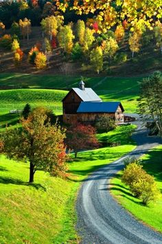 A quaint barn nestled amongst some hills as the seasons change from summer to autumn. Not sure where this is, but it's nice regardless.