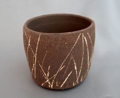 Jo Hannah. Black stoneware with white inlay.