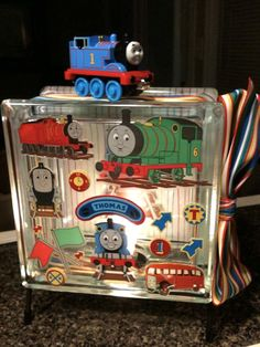 """Thomas and Friends"" lighted glass block.  I made this one for a friend's little acquaintance.  Supplies came from Hobby Lobby, Michael's and WalMart.  Ribbon came from Hancock Fabrics."