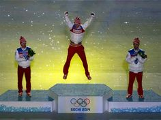 23 February Sochi 2014 - Closing Ceremony (L-R) Silver medalist Maxim Vylegzhanin of Russia, gold medalist Alexander Legkov of Russia and bronze medalist Ilia Chernousov of Russia celebrate in the medal ceremony for the Men's 50 km Mass Start Free. Last medals handed out at the games.