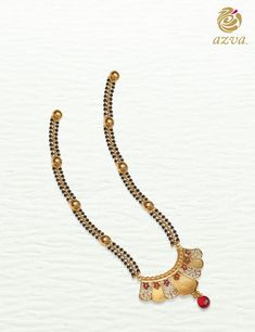 Azva gold mangalsutra of seven petals celebrate the wedding vows. Gold Chain Design, Gold Bangles Design, Jewelry Design, Bead Jewellery, Gold Jewelry, Beaded Jewelry, India Jewelry, Gold Mangalsutra Designs, Long Pearl Necklaces