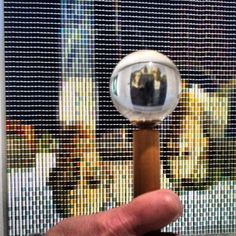 Interactive art at the Memorial Art Gallery. You need to view the piece - created with thread spools - through the glass globe to view the finished product.
