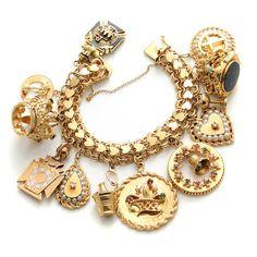A 14k gold and gem-set charm bracelet