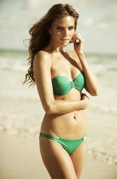 With her skinny body and Light brown hairtype without bra (cup size 60B) on the beach in bikini