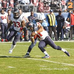 NFL Football.    Tennessee Titans' Akeem Ayers (#56) is preparing to tackle Houston Texans' Jonathan Grimes (#41) while running a 2nd down play as Greg Jones (#33) watches from the rear.       by NorkusPhoto