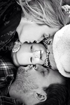 Baby and parents, kiss on the cheek