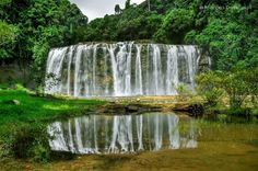 Tinuy-an Falls mirrored on the reflection pond, in Bislig City, Surigao del Sur, Philippines