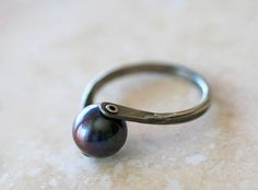 Black pearl rivet ring