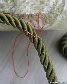 Give plain throw pillows personality by adding borders of silk cording.
