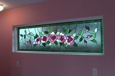 The homeowner wanted a stained glass window in the hallway leading from the main house into the addition but didn't want it to be see-through so we had this floral design custom-made to go with the color theme.