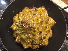 A glorious vegan/vegetarian dinner centrepiece, beautiful fractal romanesco is seasoned with fragrant za'atar & roasted whole till tender and delicious.