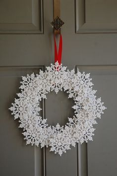 This looks like plastic snowflakes but would be gorgeous with crocheted stiffened snowflakes!