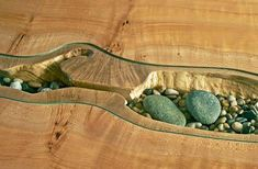 Resultado de imagem para wood table inlaid beach stones