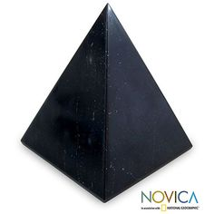 Glowing with powerful elegance, this onyx pyramid is said to bring serenity. Cesar Gonzalez sculpts the mighty sculpture, accenting clear lines as well as the beauty of this dark and mysterious stone.