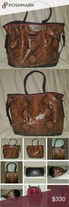 """LONGCHAMP Reptile Snake Skin Print Leather Handbag 100% authentic Longchamp Reptile Leather handbag Style # 1053740002. Very gently used only about 3 times. Excellent Condition! No Significant Flaws/Wear!Please view all photos. MSRP $595.MADE IN FRANCE!Hardware: Silver Tone Closure: Magnetic  Embellishment: Brown Leather Trim, Pleated Front Interior Pockets: One Side Zipper, two Large Side Slip and one phone pocket.  Leather Key Fob holder 13.5"""" H / 20"""" W / 7"""" D Longchamp Bags Shoulder Bags"""