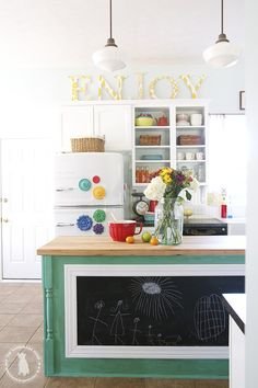 "Looking to bring in a touch of pattern in an unexpected way? The Handmade Home's tutorial for fabric-topped letters is a great place to start. Create your own message of choice (we prefer the cheerful ""enjoy"" to the timeworn ""EAT"".) Photo via The Handmade Home   - HouseBeautiful.com"