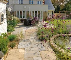 Garden Landscaping - Pavestone - Natural Paving Stone for gardens and driveways Small Courtyard Gardens, Back Gardens, Outdoor Gardens, Back Garden Design, Cottage Garden Design, Garden Paving, Garden Stones, Driveway Landscaping, Sloped Garden