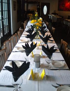 Black and yellow table setting at The Black Palm