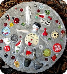 The Child's Paper: Stepping Stones - This one is mine. I added little trinkets that represented my collection of dolls, sewing notions, hearts, games, apples, cherries, soda pop, flowers and lady birds. Oh and lets not forget the reds.