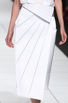 White skirt with crisp folds & perforated lines; architectural fashion details // #Issey #Miyake