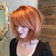 #42: long messy rounded bob with bangs. If I ever cut my hair short, this is the cut I want. I keep my hair it's naturally sophisticated golden chestnut brown.. but this copper looks so good on her it's stirring up a boldness in me to give it a try
